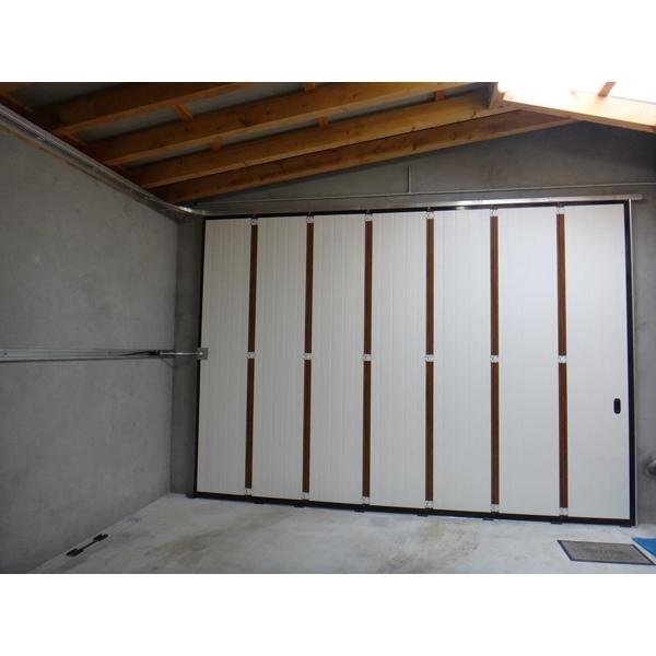 Porte de garage d placement lat ral redsea - Porte sectionnelle laterale ...